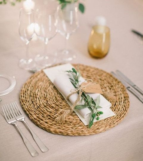 jute placemat, a white napkin, a green sprig for an elegant rustic look