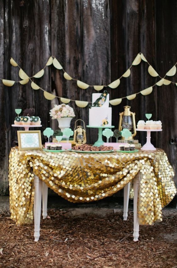mint and gold dessert table with a large sequin tablecloth