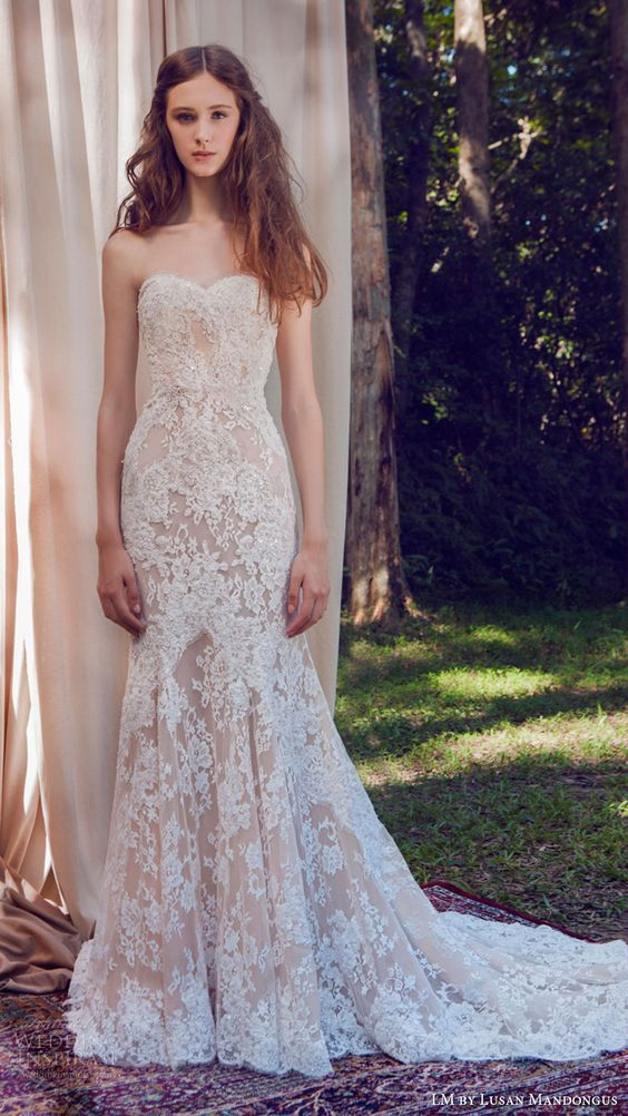 nude gown with white lace appliques and a mermaid silhouette