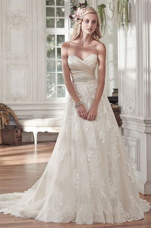 romantic lace and tulle A-line wedding dress with an embellished sash