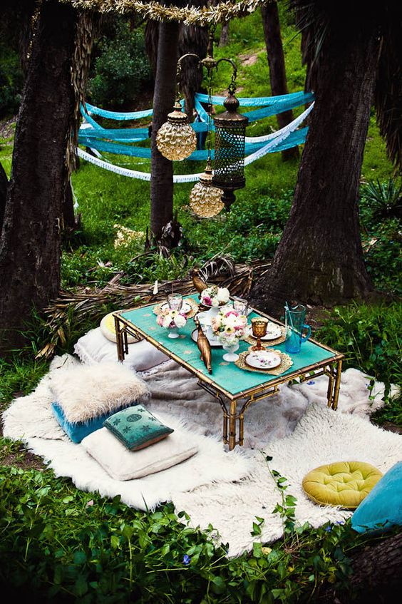 turquoise and white Morocco inspired boho setting in the forest