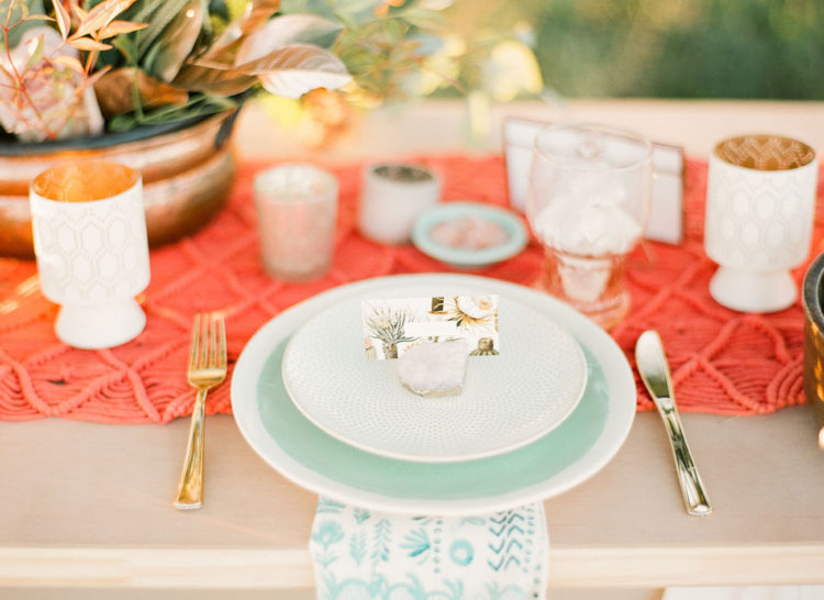 A bold macrame table runner and mint chargers created a mood