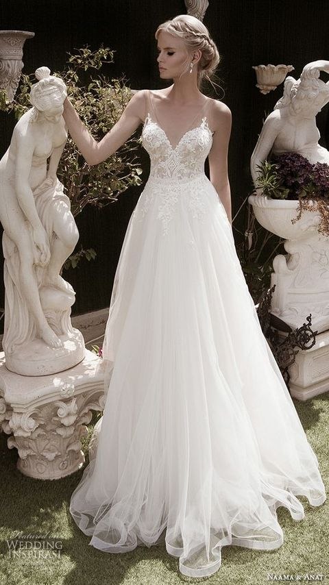 airy gown with a lace bodice and wide illusion straps