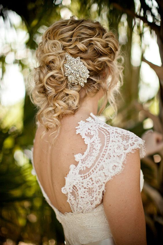 messy curled updo wwith a chic vintage jewel