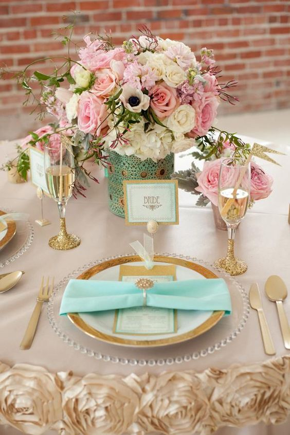 mint and gold table setting with blush and ivory flowers