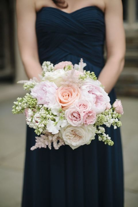 navy bridesmaid's dress and a blush bouquet
