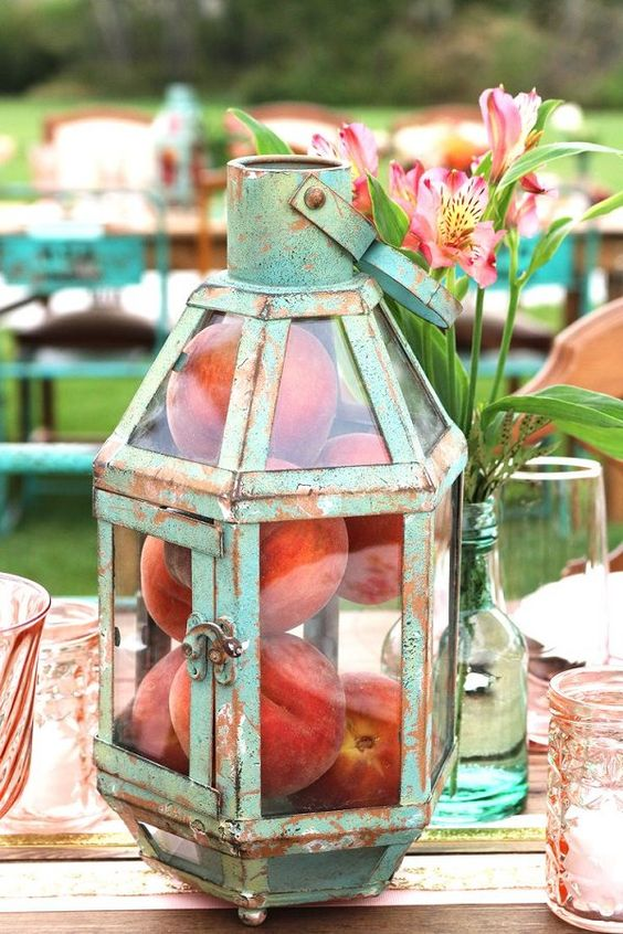 a patina lantern with real peaches inside for an edible centerpiece
