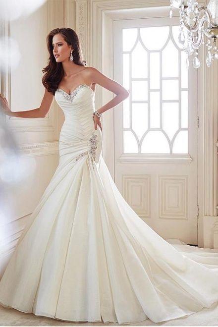 mermaid pleated dress with embellishments looks very elegant