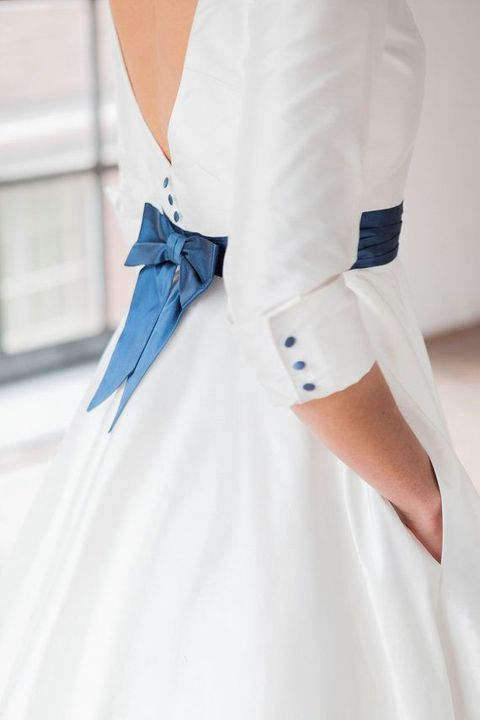 navy buttons and a sash with a bow