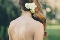 13 side swept hair with small fresh flowers to highlight it
