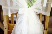 14 decorate a chairback with tulle and lavender
