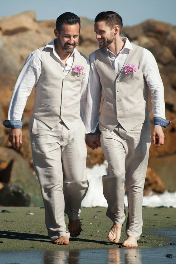 Picture Of nude vest suits and striped shirts for a beach wedding