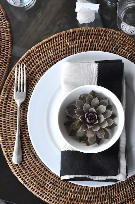 round wicker placemats, succulents, black linen napkins