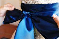 14 royal blue sash and a large bow