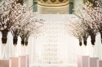 15 cherry blossom lined aisle with pillar candles looks wow