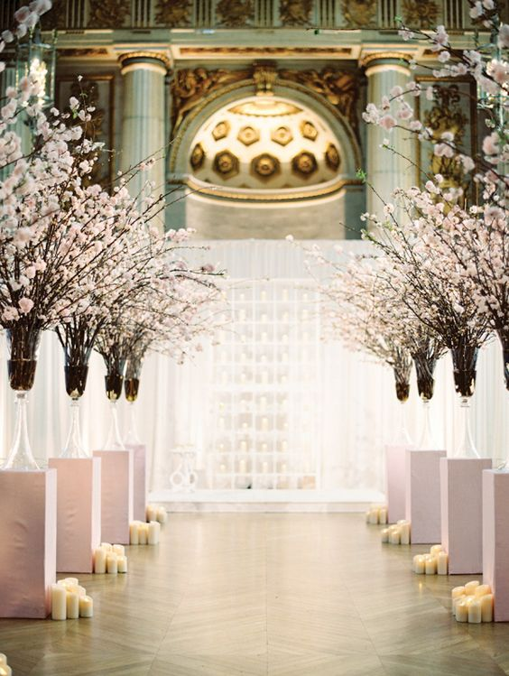 cherry blossom lined aisle with pillar candles looks wow