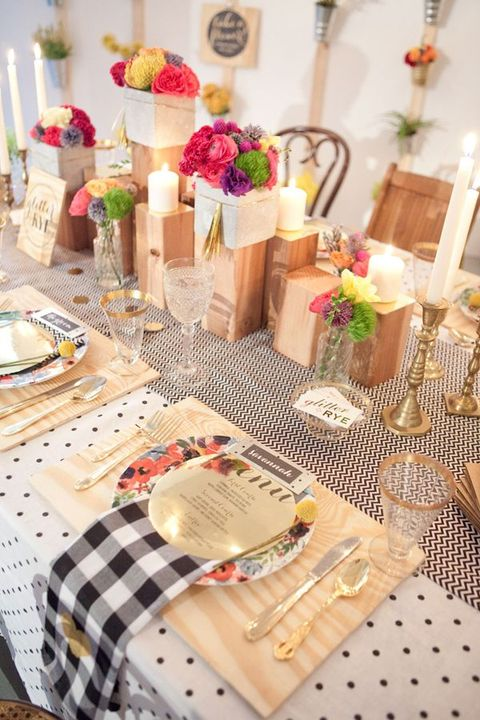 wood placemats and wooden candle and flower stands