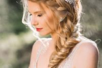 16 a side swept braid can be highlighted with a beautiful hairpiece