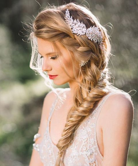 a side swept braid can be highlighted with a beautiful hairpiece