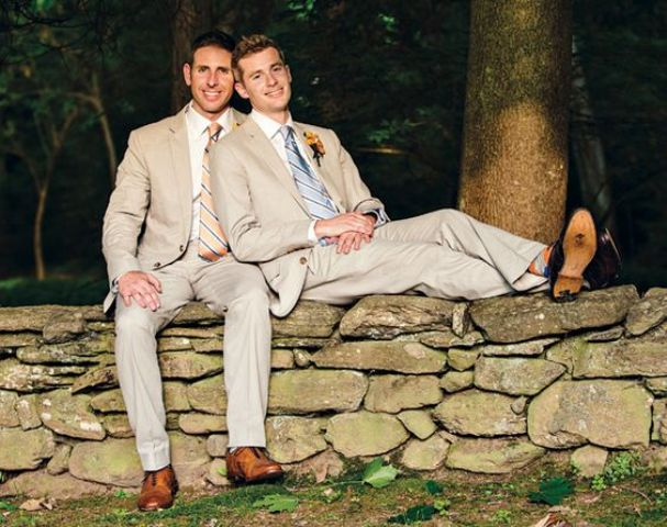 grooms in the same suits with striped ties