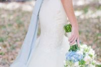 16 pale blue sash with a bow and corresponding flowers