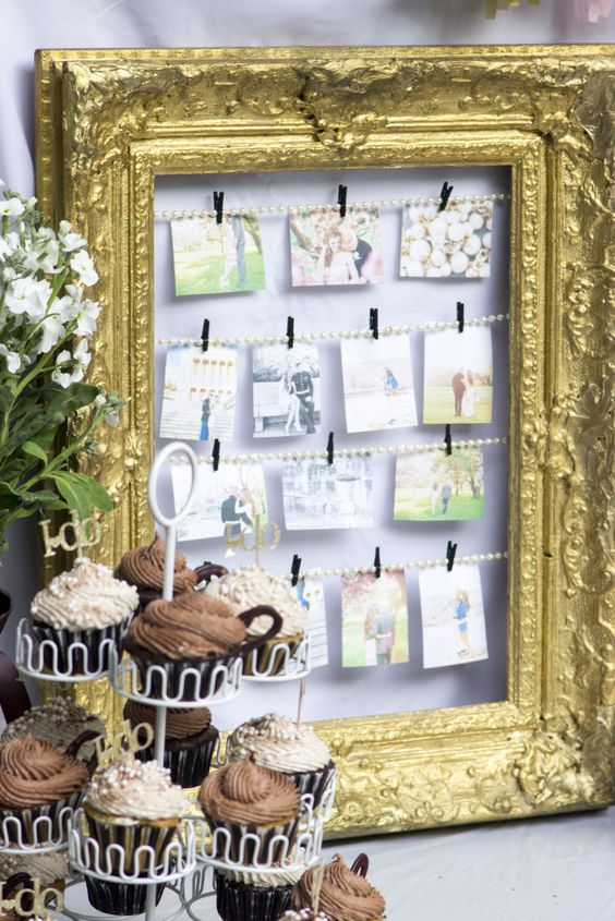take a vintage frame, string pearls and hang engagement pictures at your bridal shower