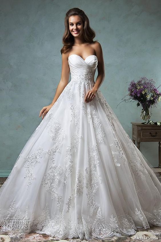 A-line ball gown with a lace skirt and a draped bodice