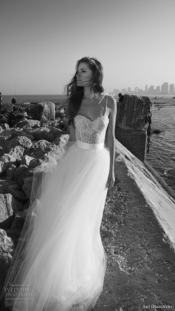 spagetti strap dress with a sweetheart neckline bustier and a heavily embellished bodice