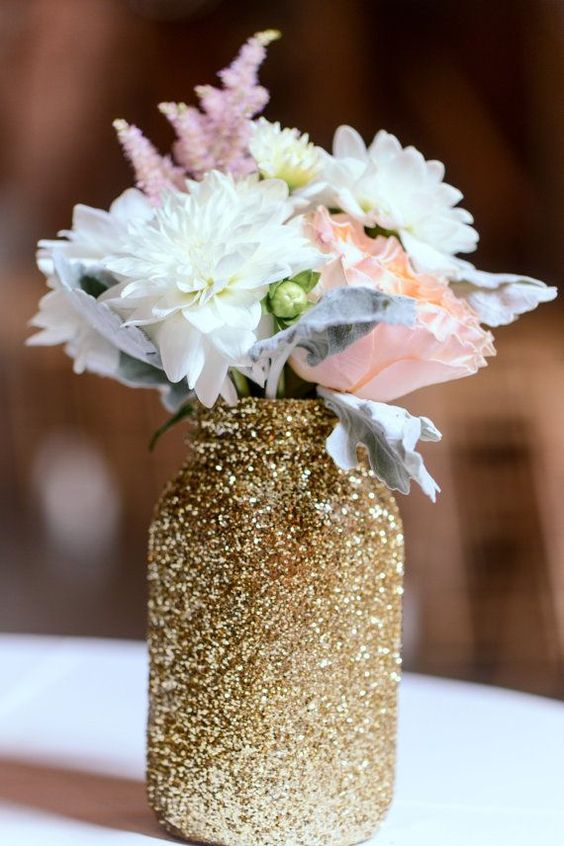 such a glitter mason jar can be made by yourself to use as a vase or centerpiece