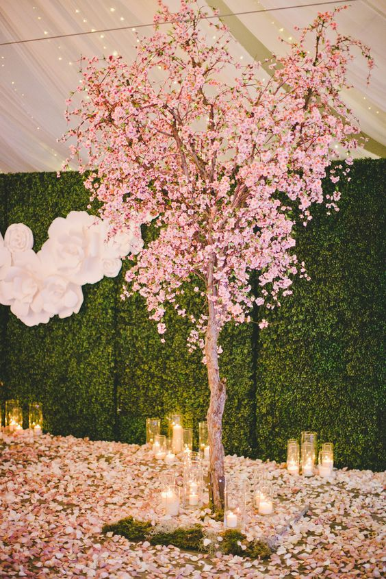 cherry blossom tree and candles for a romantic ceremony space