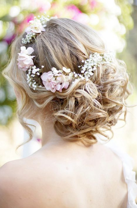 curled updo on medium hair and fresh flowers