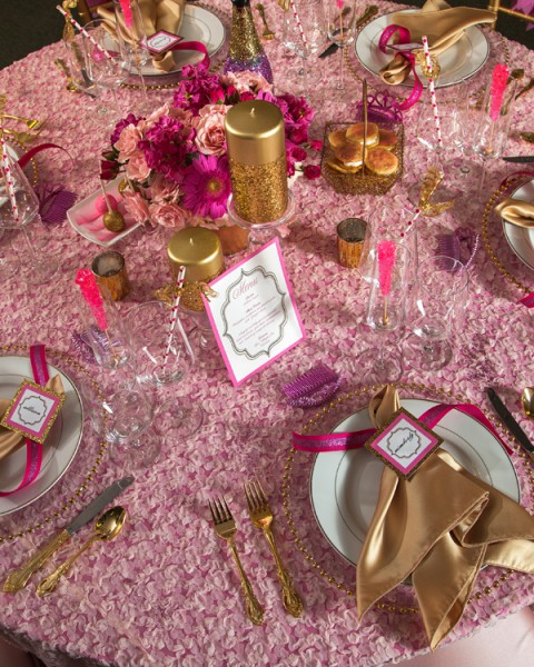super bold table setting in gold and pink colors