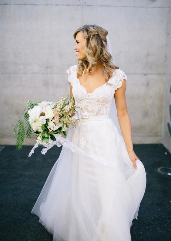 wide lace straps and a tulle skirt for a simple and chic wedding gown