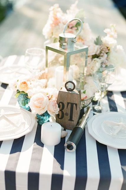 blush and ivory flowers on a striped navy and white tablecloth