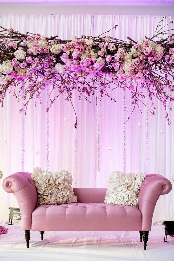 couple stage with cherry blossom and roses decor over it