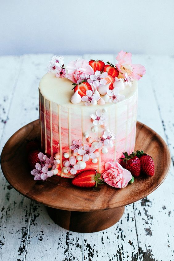ombre wedding cake with white chocolate drizzle, cherry blooms and strawberries