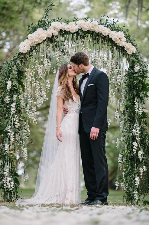 romantic greenery and white rose wedding altar