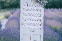 19 shabby door with escort cards in a lavender field