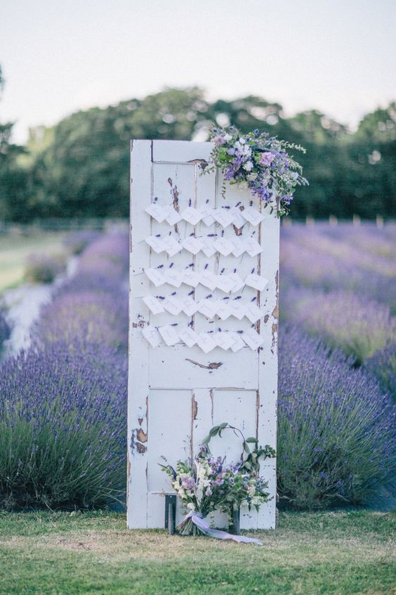 shabby door with escort cards in a lavender field