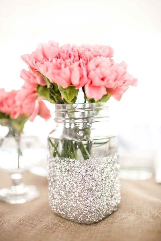 silver jar with pink flowers is another great idea for a glam centerpiece
