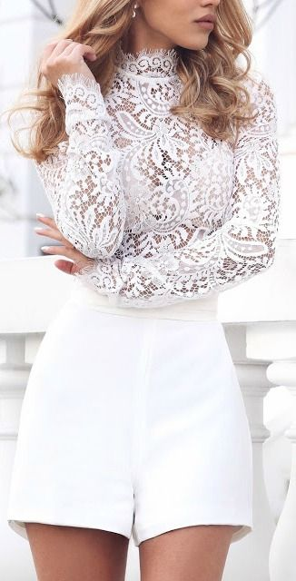 white shorts and a lace turtleneck with long sleeves