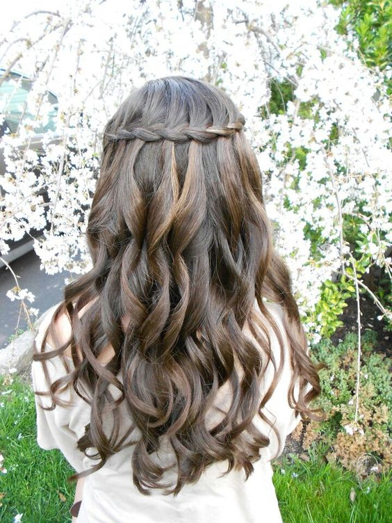 a braid with curls looks very boho-inspired