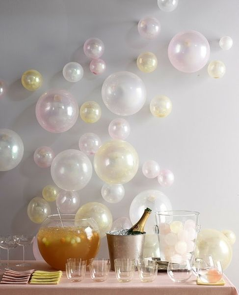 a bubbly bar with a balloon wall for fun