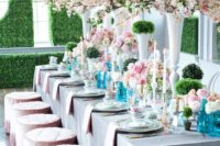20 blush cherry blossoms and roses echo with stools to create a fresh and spring-inspired look