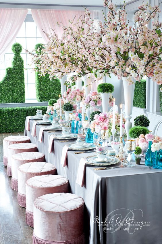 blush cherry blossoms and roses echo with stools to create a fresh and spring inspired look