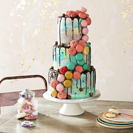 colorful macaron wedding cake with chocolate drip