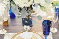 20 elegant chevron beige and white placemat, a gold charger and neutral florals