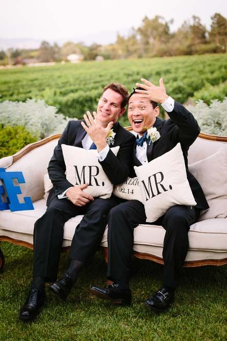 grooms in the same suits and blue ties