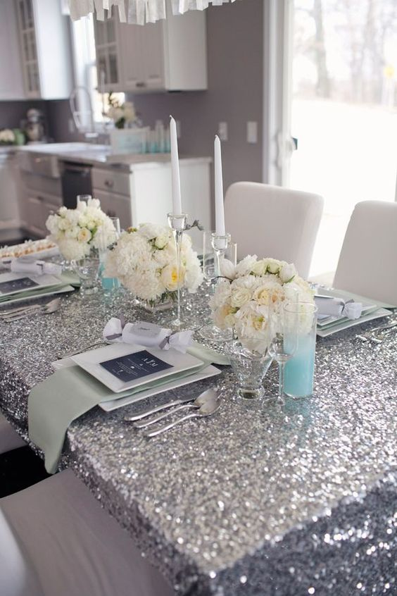 & Picture Of silver ivory and mint table setting for a glam bridal shower