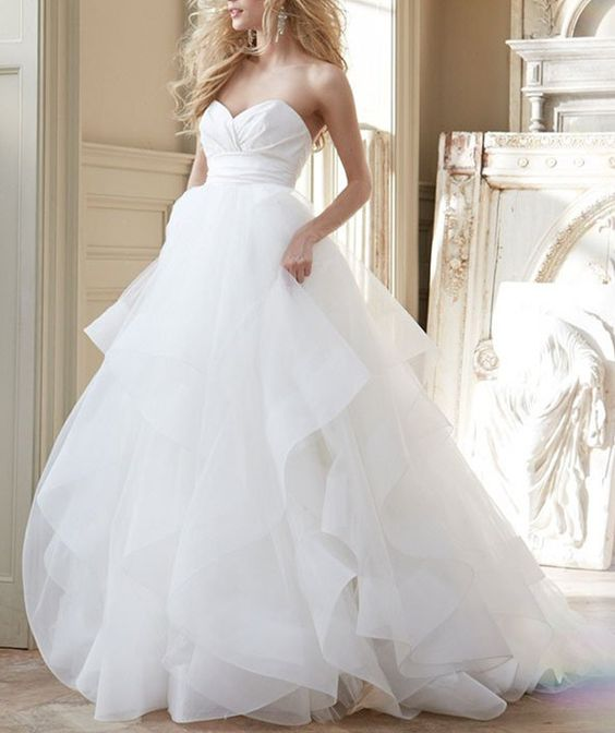 draped bodice and a layered tulle skirt make this dress look airy
